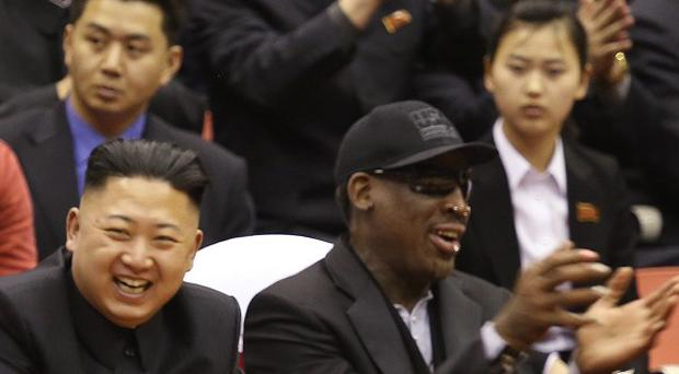 North Korean leader Kim Jong Un and former NBA star Dennis Rodman watch North Korean and US players at an arena in Pyongyang (AP)