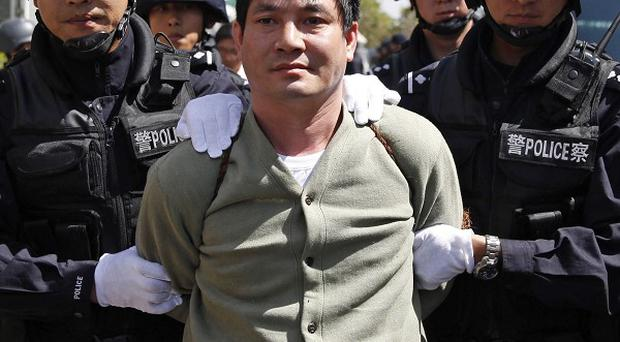 Burmese drug lord Naw Kham is taken to his execution in Kunming (AP/Xinhua)