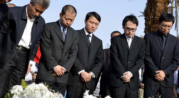 Dignitaries pay their respects to tourists from Hong Kong killed in a hot air balloon accident in Luxor, Egypt (AP)