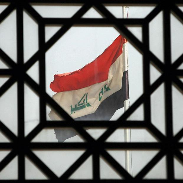 Iraqi officials say attacks in two Shiite-dominated areas in the Baghdad region have killed four people and wounded 11