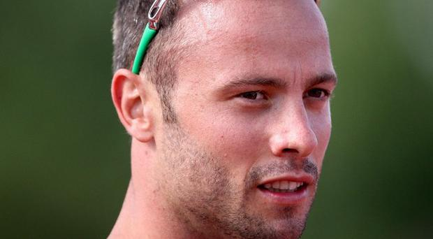 Oscar Pistorius is due to settle a three-year-old case against a former neighbour over reputation damages