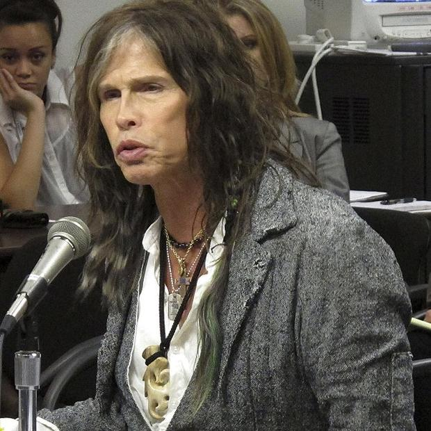 Aerosmith lead singer Steven Tyler testifying on celebrity privacy during a hearing at the Hawaii Capitol in Honolulu (AP)