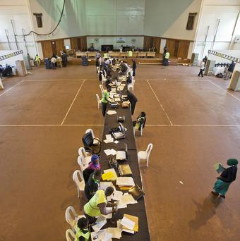 Electoral workers engage in the vote tally verification process at the National Tallying Centre in Nairobi, Kenya (AP)