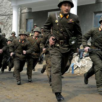 Soldiers of Kim Il Sung Military University perform military training in Pyongyang (AP)