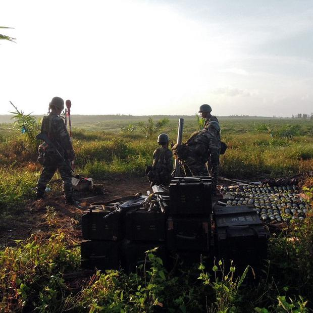 Malaysian soldiers prepare to fire mortars during the stand-off with Filipino gunmen in Borneo (AP/ Malaysia's Ministry of Defence)