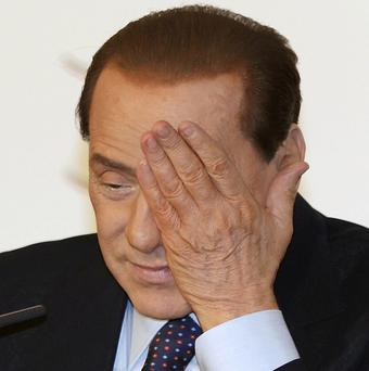 Italian Prime Minister Silvio Berlusconi has been convicted over the illegal publication of wire-tapped conversations (AP)