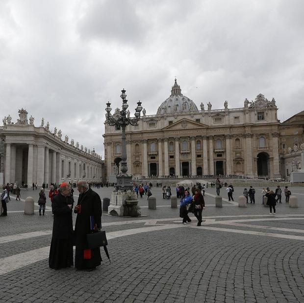 German cardinal Walter Kasper shares a word with Indian cardinal George Alencherry in St Peter's Square (AP)