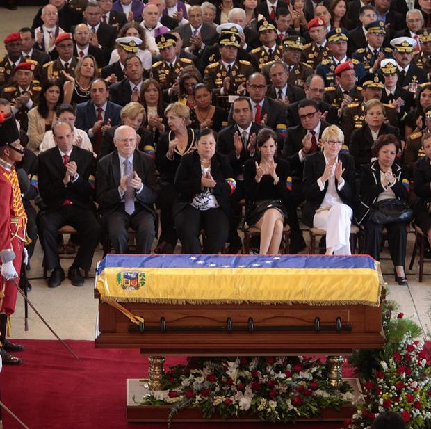 Officials attend the funeral ceremony for Venezuela's late president Hugo Chavez at the military academy in Caracas (AP/Miraflores Press Office)