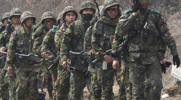 South Korean army soldiers march during an exercise near the demilitarised zone of Panmunjom in Paju, South Korea (AP/Ahn Young-joon)
