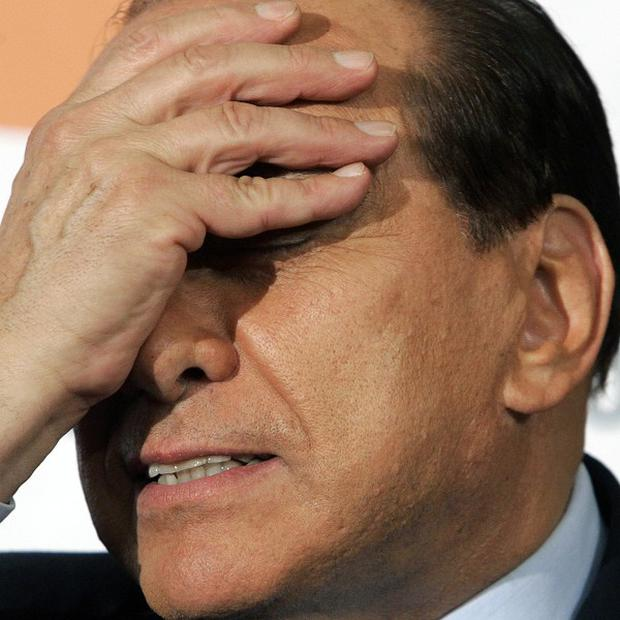 Silvio Berlusconi's lawyers say he is too ill to continue with his sex-for-hire trial (AP)