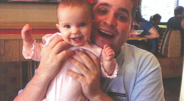 Cannibal cop Gilberto Valle with his baby daughter (AP)
