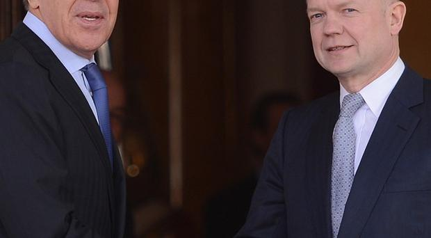 UK Foreign Secretary William Hague (right) welcomes his Russian counterpart Sergei Lavrov to the conference at London's Lancaster House