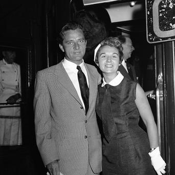 Sybil Williams Burton and her then-husband, actor Richard Burton, pose for a photo at Victoria Station in London (AP)