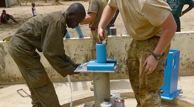 Sapper Ben Seaton is part of the team which has been helping bore water holes for the Sierra Leone army (Corporal Andy Reddy RLC/MoD/PA)