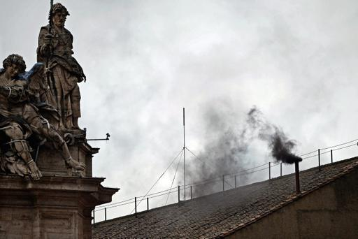 VATICAN CITY, VATICAN - MARCH 13: Black smoke billows from the chimney on the roof of the Sistine Chapel indicating that the College of Cardinals have failed to elect a new Pope on March 13, 2013 in Vatican City, Vatican. Pope Benedict XVI's successor is being chosen by the College of Cardinals in Conclave in the Sistine Chapel. The 115 cardinal-electors, meeting in strict secrecy, will need to reach a two-thirds-plus-one vote majority to elect the 266th Pontiff.. (Photo by Jeff J Mitchell/Getty Images)
