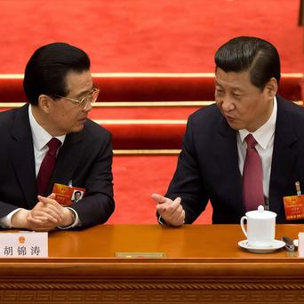 Outgoing Chinese president Hu Jintao, left, chats with incoming president Xi Jinping (AP)