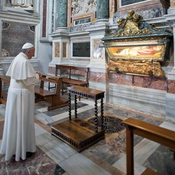 Pope Francis prays inside St Mary Major Basilica in Rome (AP/L'Osservatore Romano)