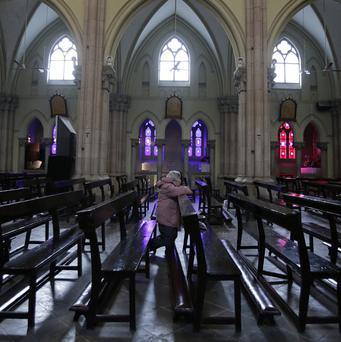 A worshipper prays at St Ignatius Cathedral in Shanghai (AP)