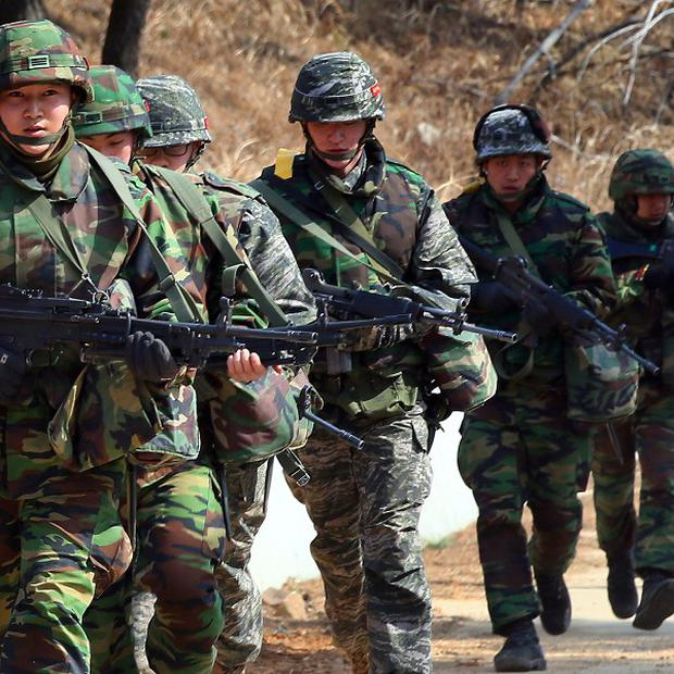 South Korean marines move during an exercise against possible attacks by North Korea on Yeonpyeong Island (AP)