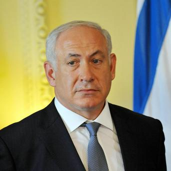 Israeli Prime Minister Benjamin Netanyahu has signed a coalition deal after weeks of negotiations