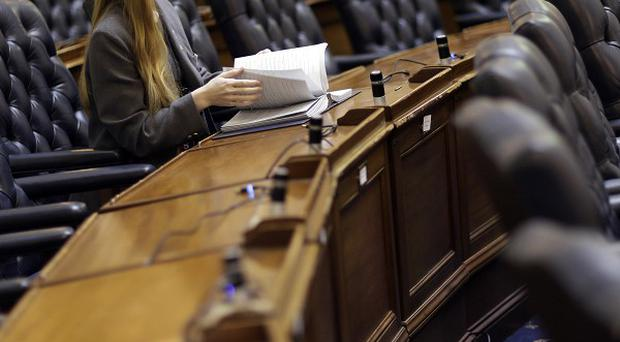 Page Anna Louise Devanny looks through a book of bills at the desk of a member of the House of Delegates in Annapolis, Maryland (AP)
