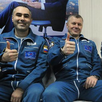 Russian cosmonauts Yevgeny Tarelkin, Oleg Novitsky, and Nasa astronaut Kevin Ford have returned from the International Space Station (AP)