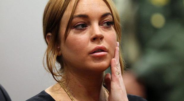 Lindsay Lohan is due to find out when her trial over three alleged misdemeanours will take place (AP)