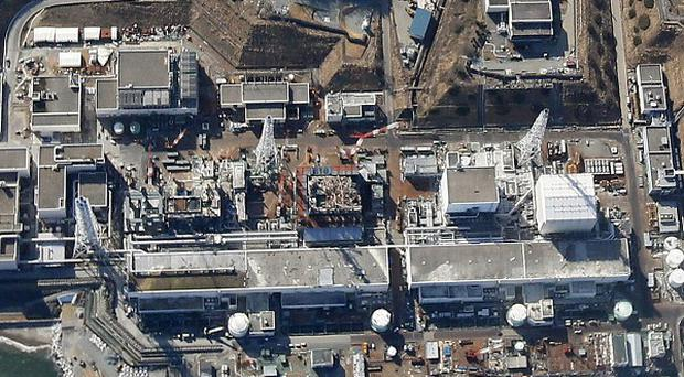 Reactor buildings at th Fukushima nuclear power plant in Okuma, northeastern Japan (AP/Kyodo News)