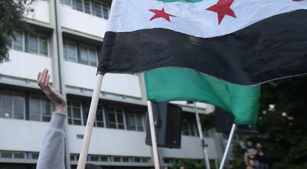 An American-educated IT manager has been elected head of an interim government in areas seized by Syrian revolutionaries (AP)