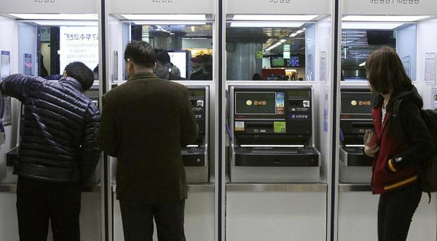 Bank machines in South Korea were paralysed in a suspected cyber attack by North Korea (AP)