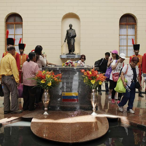People visit the tomb of Venezuela's late president Hugo Chavez at the Military Museum in Caracas (AP)