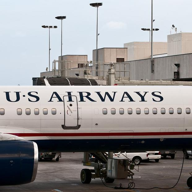 The bogus pilot was found in the cockpit of a US Airways plane