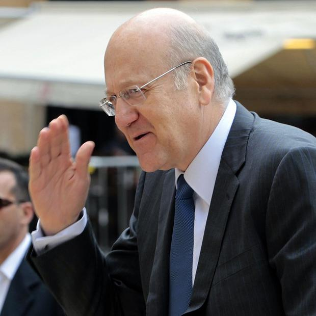 Lebanese prime minister Najib Mikati said he hoped his departure would be 'an impetus' for leaders to shoulder responsibilities