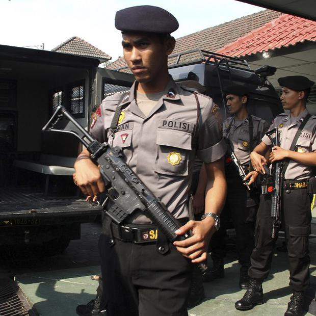 Police officers stand guard outside Cebongan prison that was attacked by unidentified gunmen, in Sleman, Indonesia (AP/Slamet Riyadi)
