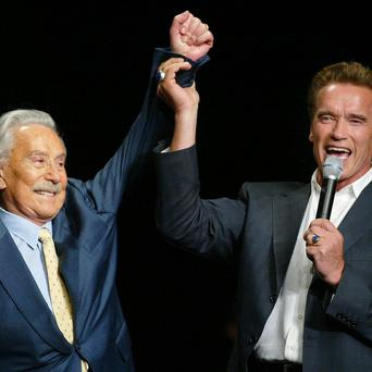 Arnold Schwarzenegger with Joe Weider during the 39th annual Mr Olympia event in Las Vegas (AP/Eric Jamison)