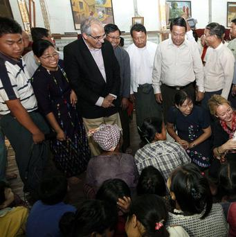 Vijay Nambiar, third from left, and Population Minister Khin Yi, center, meet refugees at a monastery in Burma (AP)