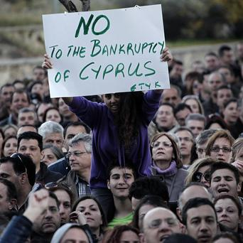 Bank employees protest outside the ministry of finance in Cyprus (AP)