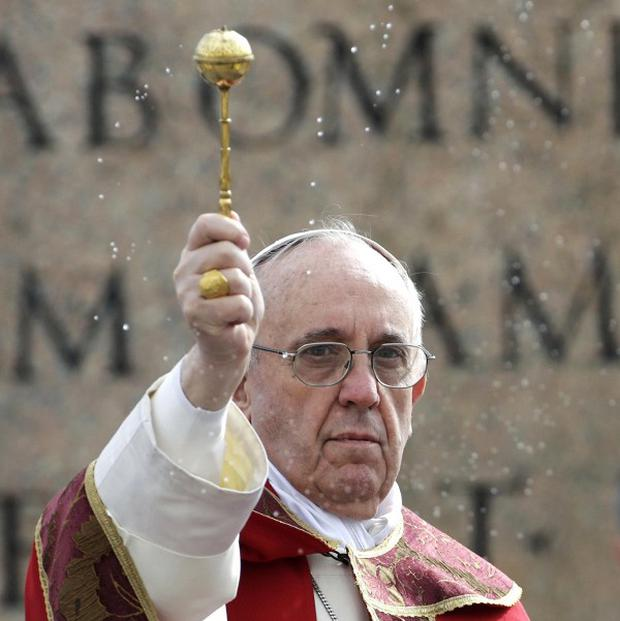 Pope Francis celebrates Palm Sunday Mass in St. Peter's Square (AP)