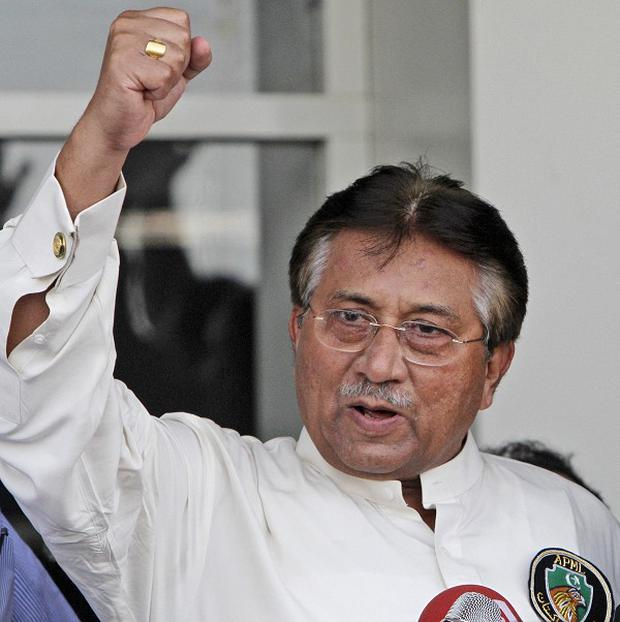 Former president Pervez Musharraf gestures to the crowd at Karachi Airport upon his return to Pakistan (AP)