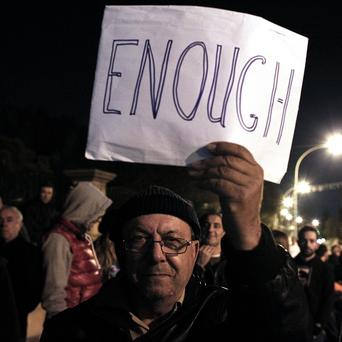 Protestors outside the Cyprus Presidential Palace in Nicosia demonstrate against the terms of a proposed bailout for Cyprus (AP)