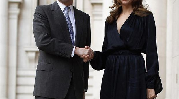 Actress and United Nations special envoy Angelina Jolie with Foreign Secretary William Hague