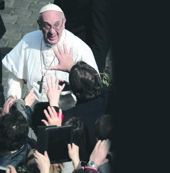 Pope Francis meets pilgrims around St Peter's Square following the Palm Sunday Mass