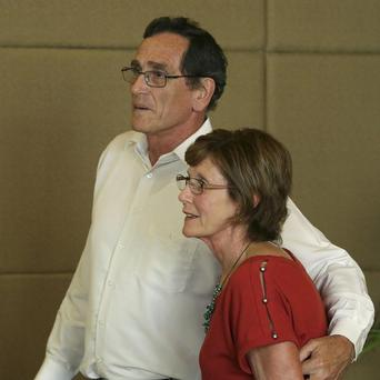 Wayne Rodwell and Denise Capello, the brother and sister of released Australian hostage Warren Rodwell (AP/Aaron Favila)