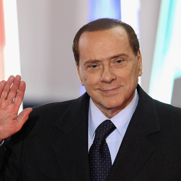 The ad showed Silvio Berlusconi smiling from the driver's seat alongside the slogan 'Leave your worries behind'