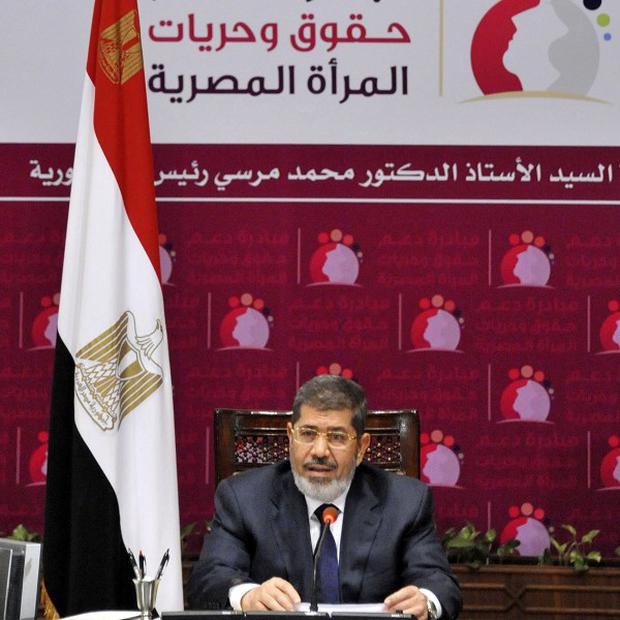 Egyptian president Mohammed Morsi has raised import duties on luxury goods (AP)
