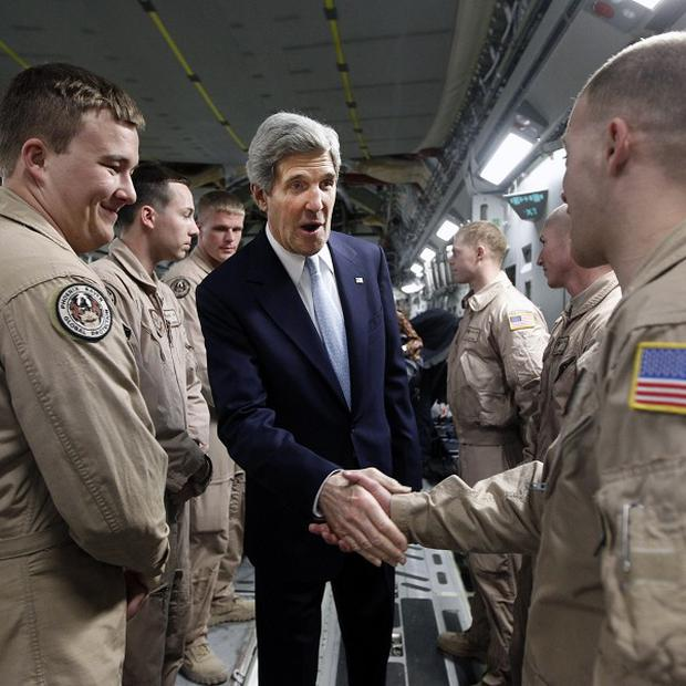 US Secretary of State John Kerry has made a surprise visit to Afghanistan (AP)