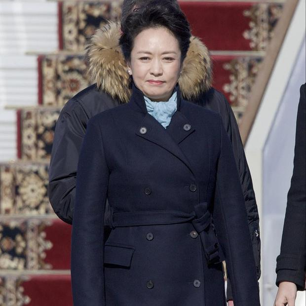 Chinese President Xi Jinping's wife Peng Liyuan smiles after arriving at the government airport Vnukovo II, outside Moscow (AP)