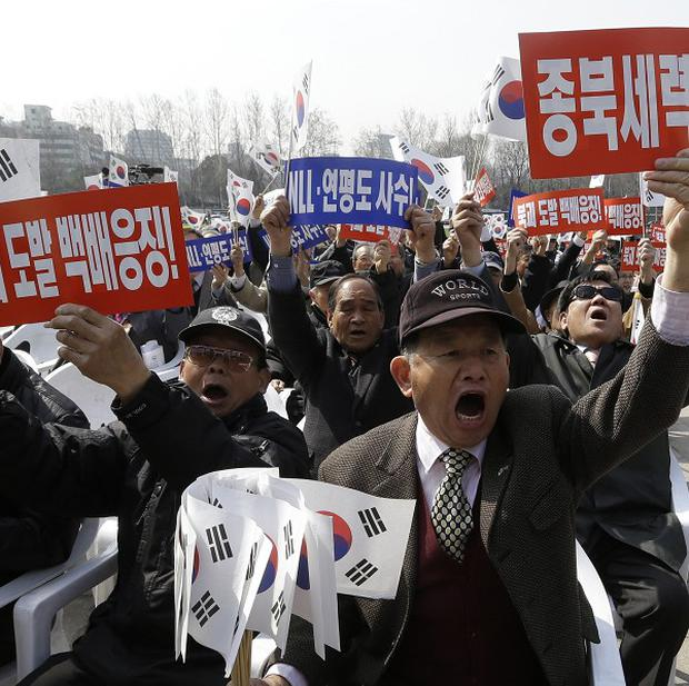 South Koreans mark the anniversary of the 2010 sinking of a naval ship which killed 46 sailors near the maritime border with North Korea (AP)