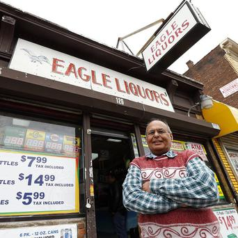 The US shop and its owner which solde the winning ticket (AP)