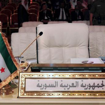 The Syrian revolutionary flag in front of the seat of the Syrian delegation at the Arab League summit (AP)